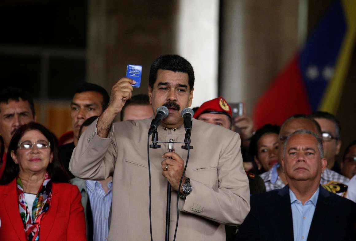 Venezuela's President Nicolas Maduro holds a copy of the Venezuelan constitution as he speaks during a gathering outside the National Electoral Council (CNE) where he presented his proposal to set up a National Constituent Assembly, in Caracas, Venezuela May 3, 2017. Credit: Reuters/Marco Bello