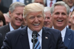US President Donald Trump speaks with House Freedom Caucus Chairman Mark Meadows (L) and House Majority Leader Kevin McCarthy (R) behind him as Trump gathered with Congressional Republicans in the Rose Garden of the White House after the House of Representatives approved the American Healthcare Act, to repeal major parts of Obamacare and replace it with the Republican healthcare plan, in Washington, US, May 4, 2017. Credit: Reuters/Carlos Barria