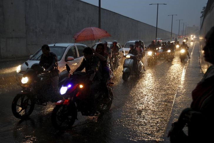 Commuters on their vehicles move through an underpass during a heavy rain shower in Ahmedabad, September 18, 2015. Credit: Reuters/Amit Dave/Files