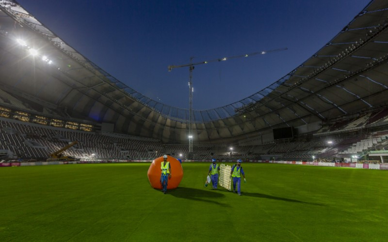FILE PHOTO: Construction workers are seen at Khalifa International Stadium in Doha in this undated handout photo. Qatar's Supreme Committee for Delivery & Credit: Legacy/Handout/File Photo via Reuters