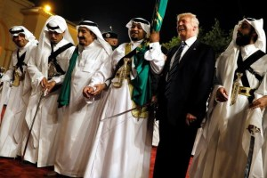 US President Donald Trump dances with a sword as he arrives to a welcome ceremony by Saudi Arabia's King Salman bin Abdulaziz Al Saud at Al Murabba Palace in Riyadh, Saudi Arabia May 20, 2017. Credit: Reuters/Jonathan Ernst