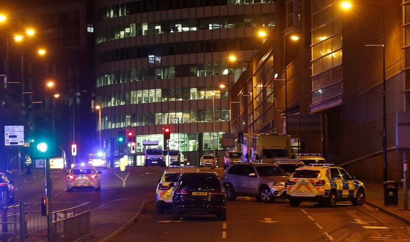 Vehicles are seen near a police cordon outside the Manchester Arena, where U.S. singer Ariana Grande had been performing, in Manchester, northern England, Britain, May 23, 2017. Credit: Reuters/Andrew Yates
