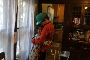 Armand Melk-Johnson, 15, hugs his host sister, Mariel, goodbye. Credit: Max Nesterak/Global Voices