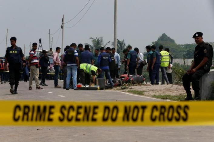 Crime Scene Unit works on the spot where police shot dead a suspected militant who tried to enter a security checkpost on a motorcycle armed with explosives in Khilgaon, outskirt of Dhaka, Bangladesh, March 18, 2017. REUTERS/Mohammad Ponir Hossain