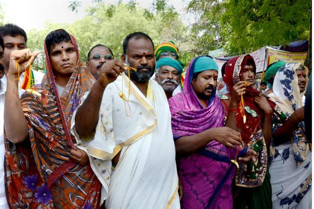 Farmers from Tamil Nadu disguised as women during protests in New Delhi. Credit: PTI
