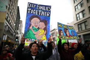 People participate in a protest march calling for human rights and dignity for immigrants, in Los Angeles, February 18, 2017. Credit: Reuters/Lucy Nicholson