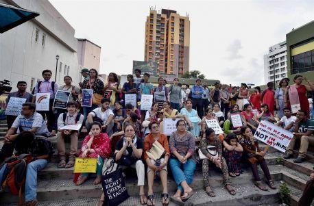 People in Kolkata hold placards. Credit: PTI