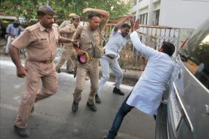 Police and members of Adityanath's security assault a protester, outside the Lucknow University campus last Wednesday. Credit: PTI