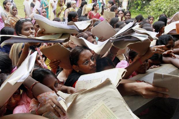 Unemployed girls tussle for registration at an employment exchange office in Allahabad, India. Credit: PTI