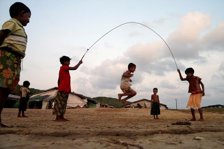 Boys play inside a Rohingya refugee camp outside Kyaukpyu in Rakhine state, Myanmar May 17, 2017. Picture Taken May 17, 2017. REUTERS/Soe Zeya Tun/Files