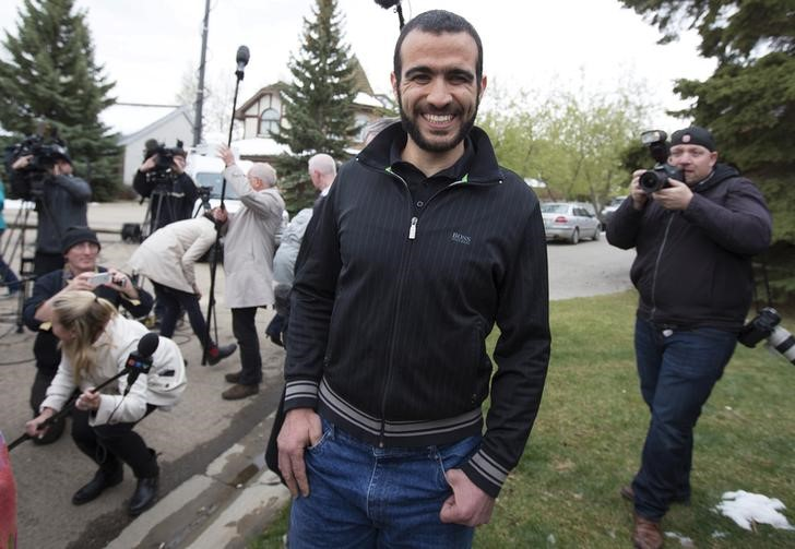 Omar Khadr leaves a news conference after being released on bail in Edmonton, Alberta, May 7, 2015. Khadr, a Canadian, was once the youngest prisoner held on terror charges at Guantanamo Bay. Credit: Reuters/Todd Korol/File Photo