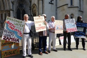 Protesters hold plaques outside the Royal Courts of Justice in London, Britain July 5, 2017. Credit: Reuters/Barbara Lewis