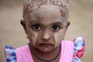 A girl wears thanakha powder on her face in a Rohingya refugee camp outside Kyaukpyu in Rakhine state, Myanmar, May 17, 2017. Credit: Reuters/Soe Zeya Tun
