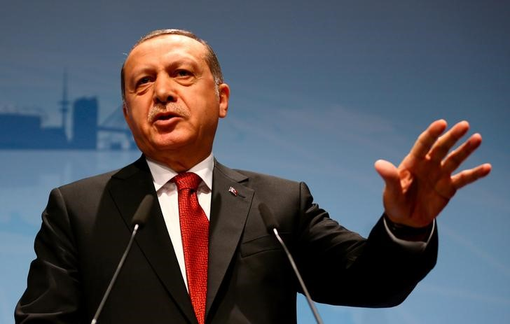 Erdogan threatens to 'chop off traitors' heads' in coup bid anniversary speech