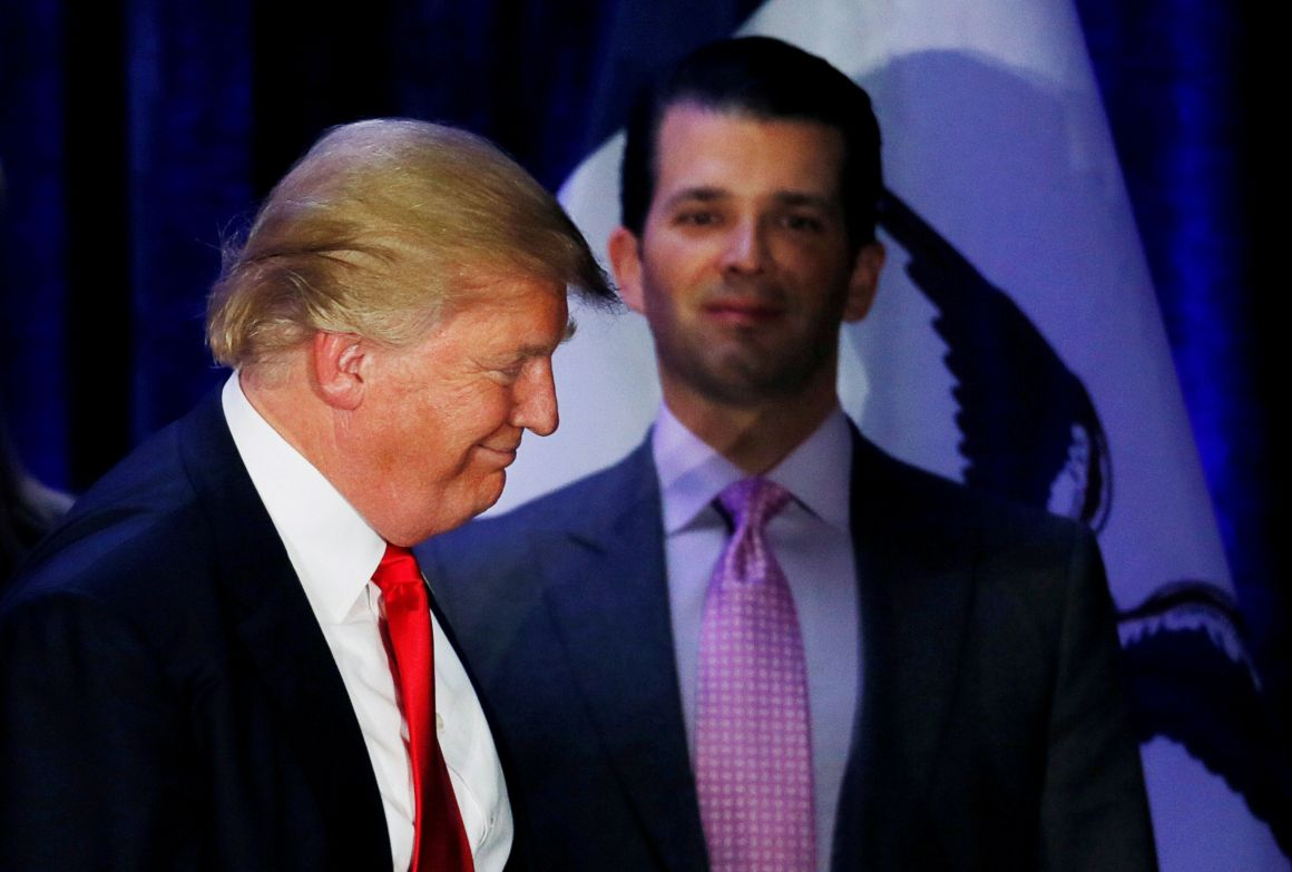 Donald Trump Jr. (R) watches his father Republican U.S. presidential candidate Donald Trump leave the stage on the night of the Iowa Caucus in Des Moines, Iowa U.S. February 1, 2016. Credit: Reuters/Jim Bourg