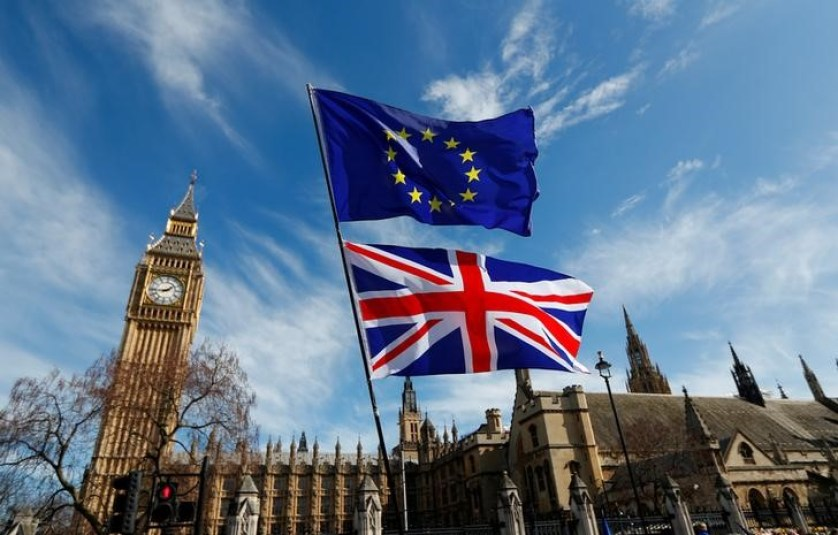 EU and Union flags fly above Parliament Square in London, Britain March 25, 2017. Credit: Reuters/Peter Nicholls/Files