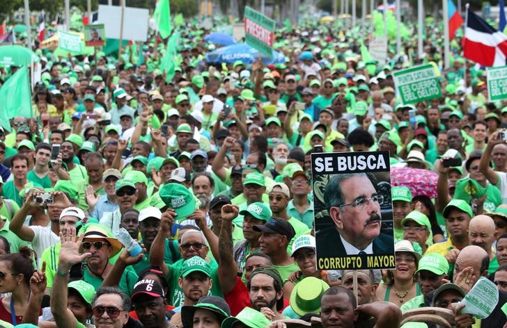 People march during a protest against corruption and the Brazilian conglomerate Odebrecht SA, in Santo Domingo, Dominican Republic, July 16, 2017. The sign reads 'Wanted corrupt senior'. Credit: Reuters/Ricardo Rojas