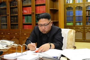 Kim Jong Un signs the order to carry out the test-fire of inter-continental ballistic rocket Hwasong-14. Credit: KCNA/via Reuters