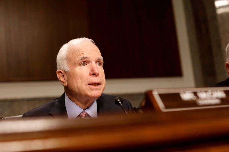 FILE PHOTO: Committee chairman senator John McCain (R-AZ) asks a question during a Senate Armed Services Committee hearing on the Marines United Facebook page on Capitol Hill in Washington, DC, U.S. March 14, 2017. Credit: Reuters/Aaron P. Bernstein/File Photo
