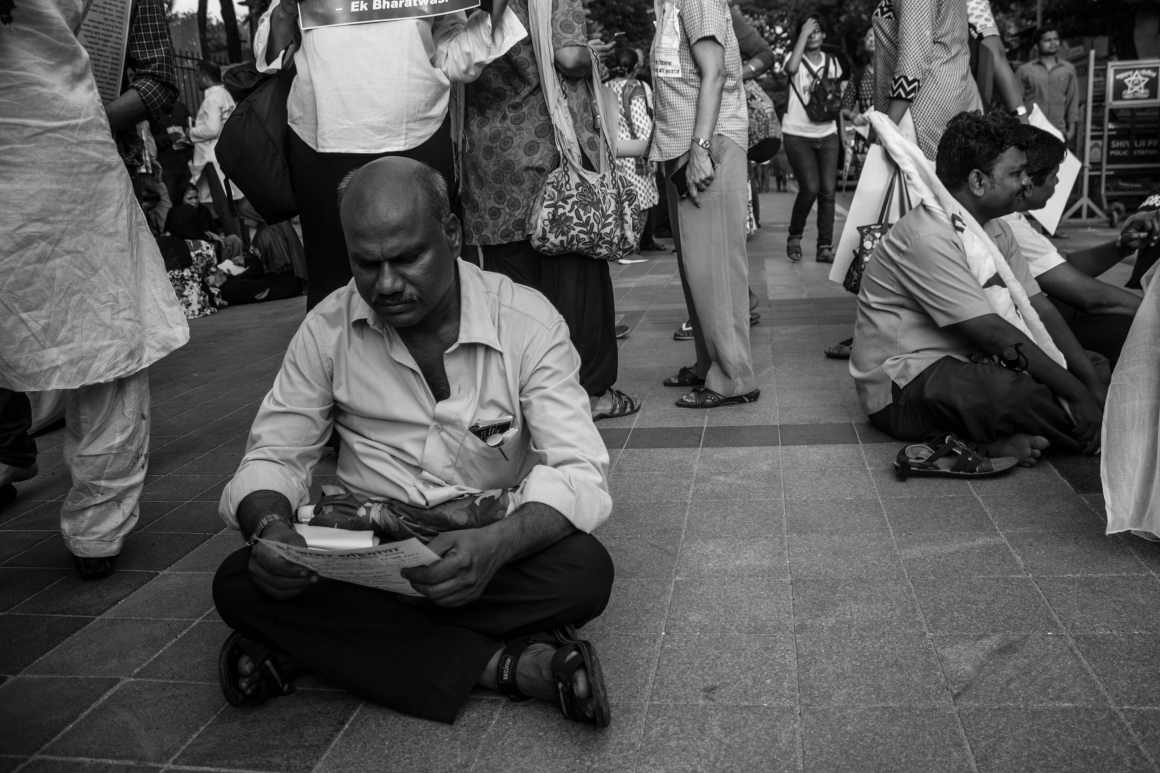 A man reads a note during the protest. Credit:Prthvir Solanki
