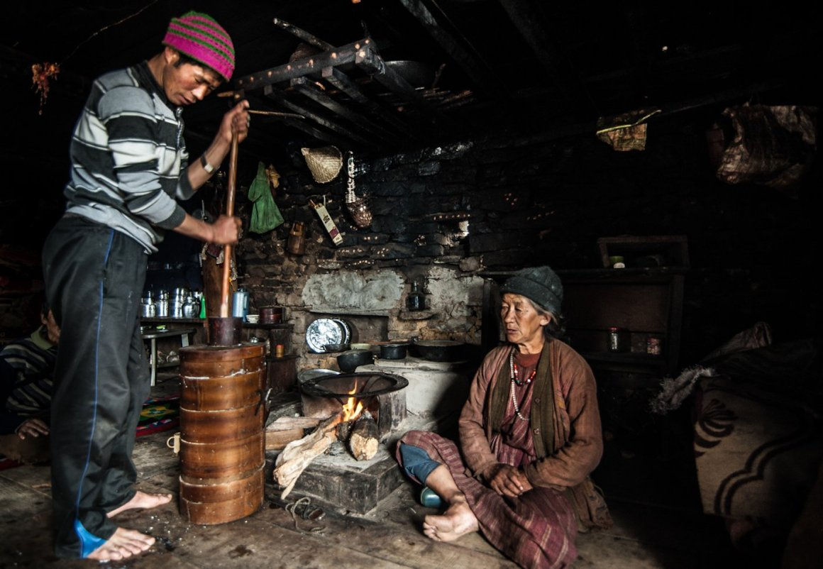 A Brokpa herdsman making butter and churpi (traditional cheese) in his winter settlement in Lagam. Both items bring in some income for Brokpa families. Credit: Ritayan Mukherjee