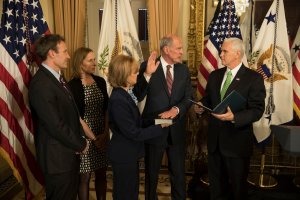 Daniel Coats (third from left) during his swearing in session with Mike Pence (Right). Credit: Wikimedia Commons