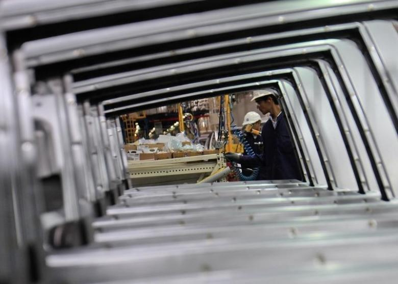 Representative image: Employees are seen working through the doors of Chevrolet Beat cars on an assembly line at the General Motors plant in Talegaon, about 118 km from Mumbai September 3, 2012. Credit: Reuters/Danish Siddiqui