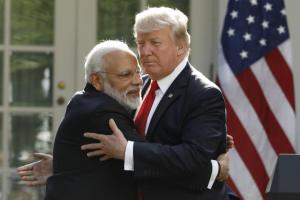 India's Prime Minister Narendra Modi hugs President Donald Trump as they give joint statements in the Rose Garden of the White House in Washington. Credit: Reuters/Kevin Lamarque