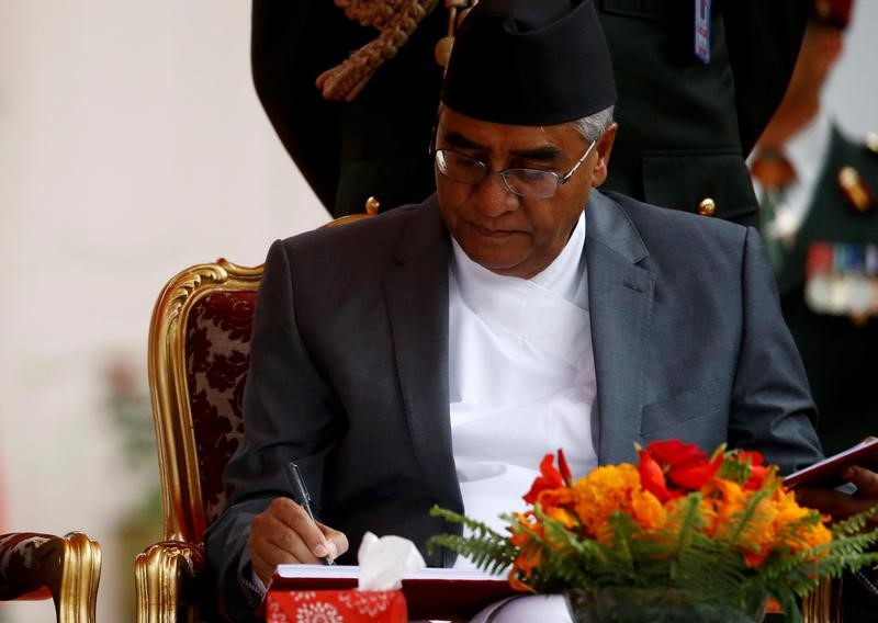 FILE PHOTO: Nepalese Prime Minister Sher Bahadur Deuba signs the oath after swearing-in ceremony at the presidential building in Kathmandu, Nepal, June 7, 2017. Credit: Reuters/Navesh Chitrakar/Files