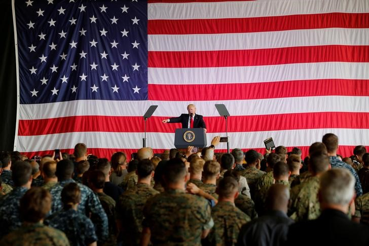 FILE PHOTO: US President Donald Trump delivers remarks to US military personnel at Naval Air Station Sigonella following the G7 Summit, in Sigonella, Sicily, Italy, May 27, 2017. Credit: Reuters/Darrin Zammit Lupi/File Photo