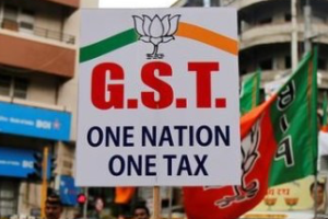 A supporter of India's ruling Bharatiya Janata Party (BJP) holds a placard during a rally to support implementation of the Goods and Services Tax (GST) in Mumbai, India, June 30, 2017. Credit: Reuters/Shailesh Andrade/Files