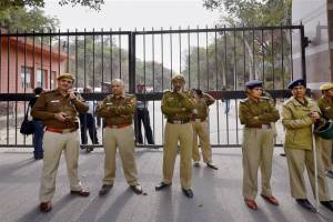 Police outside the JNU main gate during student protests last year, when three students were arrested on sedition charges. Credit: PTI/Kamal Singh