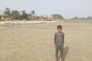 A boy standing near a river channel in Saharsa district, Bihar. Credit: Ranjeet Kumar Sahani