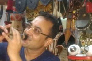 Artiste Prashanna Gogoi playing the juria pepa at his studio in Guwahati. Credit: Sangeeta Barooah Pisharoty