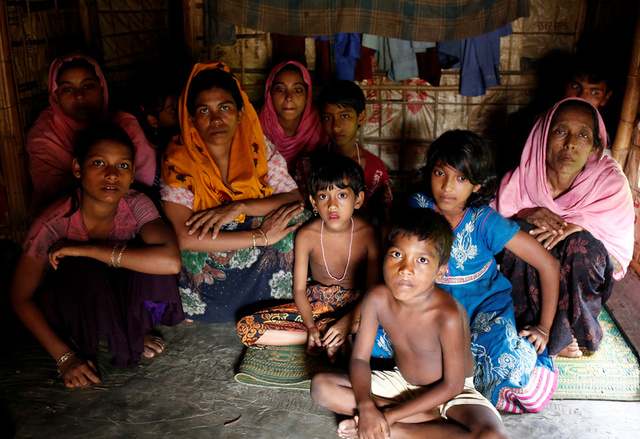 A group of Rohingya refugees takes shelter at the Kutuupalang makeshift refugee camp, after crossing the Myanmar-Bangladesh border today in Cox's Bazar, Bangladesh, August 26, 2017. Credit:Reuters