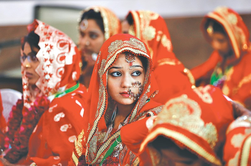 Brides sit and wait for their turn during a Muslim mass wedding in Ahmedabad, India. Credit: Reuters