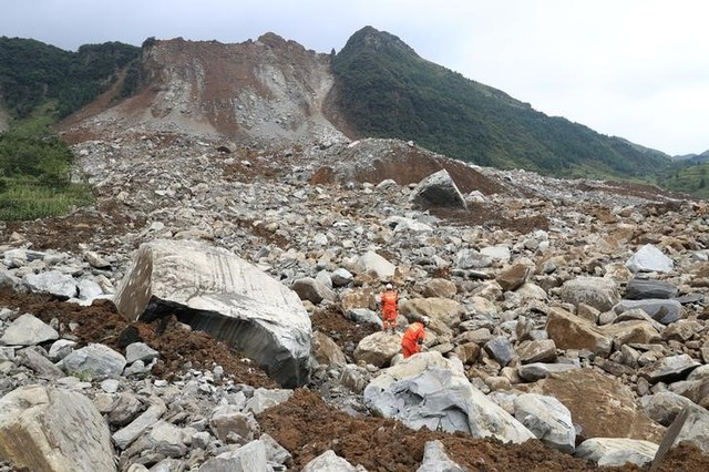 Government says 1 dead, 37 missing in south China landslide