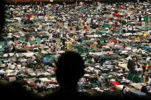 A man looks at evacuees from New Orleans sheltering at the Astrodome stadium in Houston, Texas, September 4, 2005: Credit: Reuters