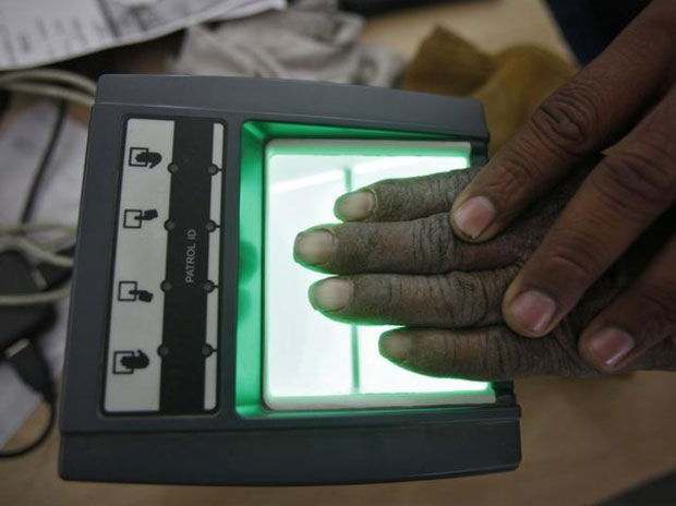 A villager goes through the process of a fingerprint scanner for the Unique Identification (UID) database system at an enrolment centre at Merta district in Rajasthan. Credit: Reuters