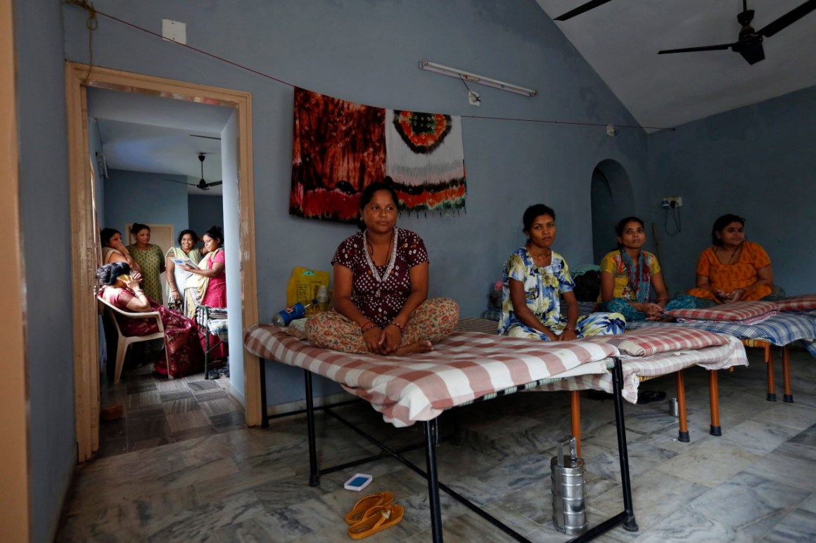 Surrogate mothers rest inside a temporary home for surrogates, provided by Akanksha IVF centre, in Anand. Credit: Reuters/Mansi Thapliyal/Files
