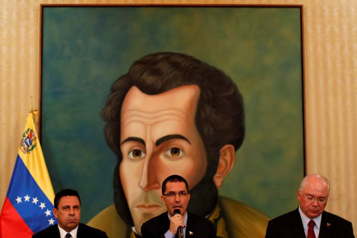 Venezuela's Foreign Minister Jorge Arreaza delivers a speech in front of a graffiti of Venezuela's national hero Simon Bolivar, during a meeting of accredited diplomatic teams in Caracas, Venezuela, August 12, 2017. Credit: Reuters/Carlos Garcia Rawlins