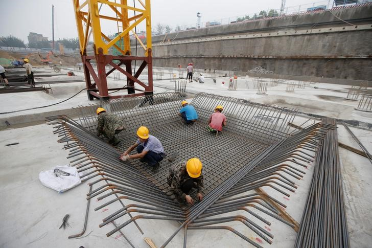 Labourers work at a construction site in Beijing, China July 20, 2017. Credit: Reuters/Jason Lee/Files