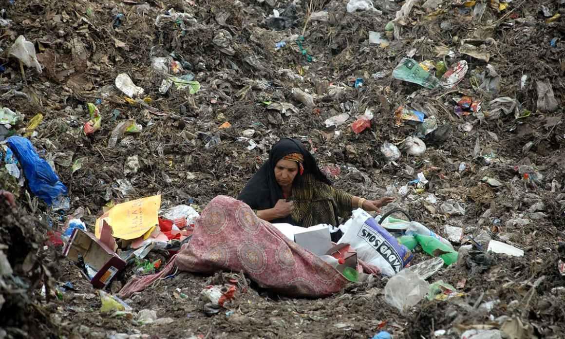 An elderly waste picker at a garbage dump in Lalazar Colony, Peshawar   Shahbaz Butt, White Star