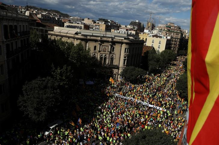 """A banner reading """"Independence Now"""" is carried as thousands of people gather for a rally on Catalonia's national day 'La Diada' in Barcelona, Spain, September 11, 2017. Credit: Reuters/Susana Vera"""