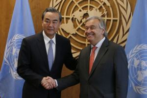 Chinese Foreign Minister Wang Yi (L) shakes hands with United Nations Secretary General Antonio Guterres prior to their meeting at U.N. headquarters in New York, U.S., September 18, 2017. Credit: Reuters/Brendan McDermid