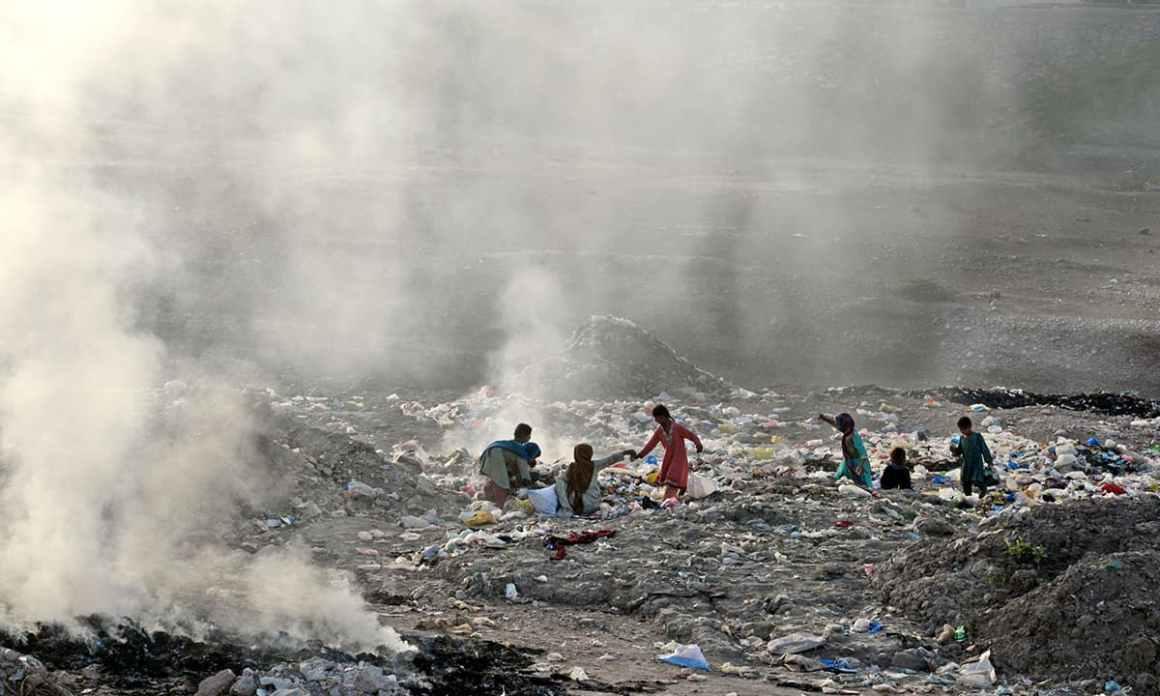 Children scavenge at a garbage dump in Hayatabad , Peshawar   Shahbaz Butt, White Star