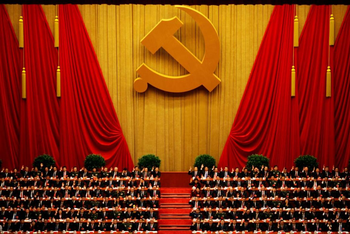 A general view shows delegates raising their hands as they take a vote at the closing session of the 18th National Congress of the Communist Party of China at the Great Hall of the People in Beijing November 14, 2012. Credit: Reuters/Carlos Barria/File Photo