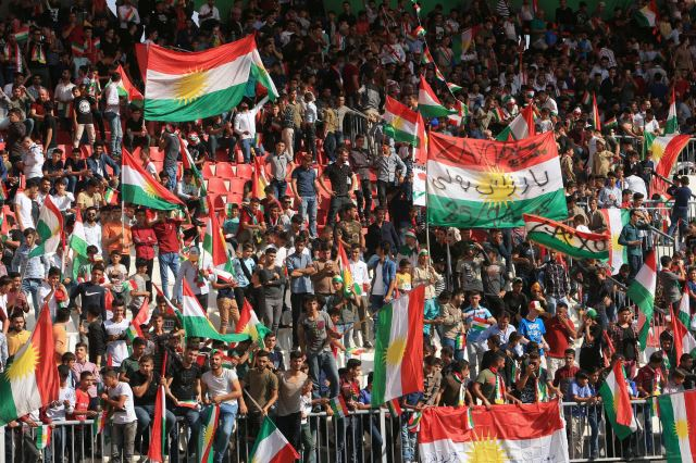 People celebrate to show their support for the upcoming September 25th independence referendum in Zakho Iraq