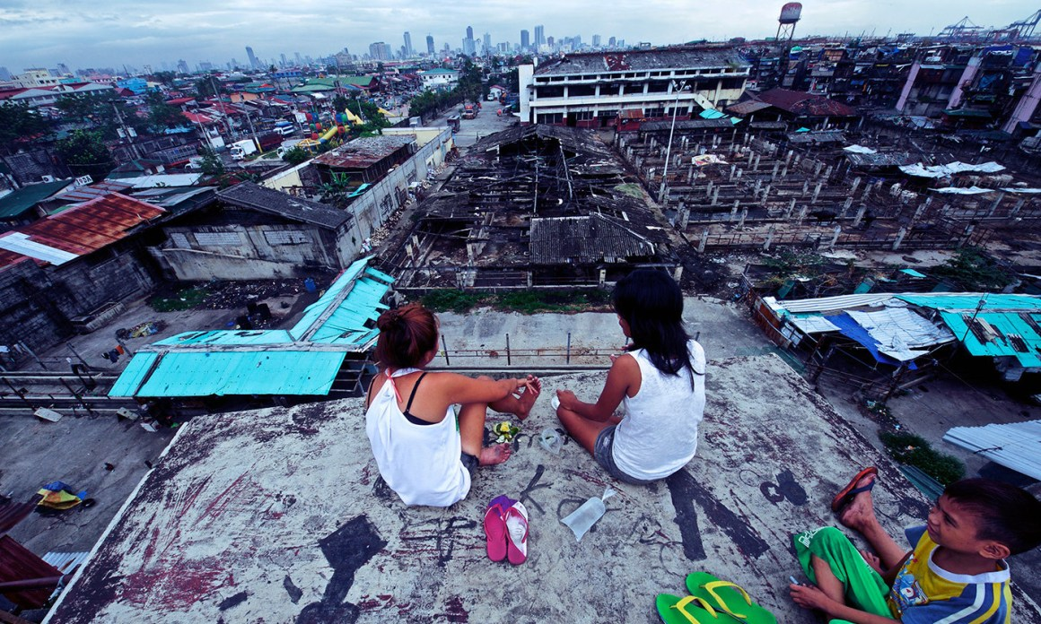 Relaxing on a Manila rooftop. Photo Credit: John Christian Fjellestad/Flickr