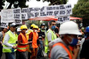 "Rescue workers and volunteers walk past signs reading ""We are an example to the world,"" ""I want to become a Mexican when I grow up,"" and ""Mexico will not fall"" among other quotes, after an earthquake in Mexico City, Mexico Mexico City, Mexico September 24, 2017. Credit: Reuters/Edgard Garrido"